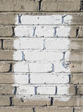 Parede de tijolo cinzenta com retângulo pintado branco fotografia de stock