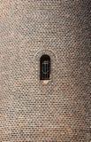 Parede de tijolo com a janela fotografia de stock
