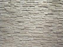 Parede de tijolo de pedra da textura da telha surgida Foto de Stock Royalty Free