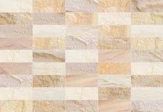 A parede de tijolo do arenito modelou (o fundo da textura dos testes padrões naturais) Fotografia de Stock Royalty Free