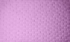 Parede de tijolo do fundo cor-de-rosa da textura da cor na sala imagens de stock