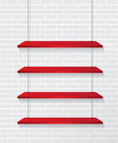 Parede de tijolo e prateleiras vermelhas Fotos de Stock Royalty Free
