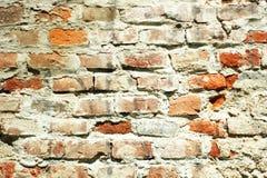 Parede de tijolo golpeada Imagens de Stock