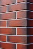 A parede de tijolo limpa e nova textured o fundo vermelho Fotografia de Stock Royalty Free