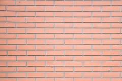 A parede de tijolo marrom vermelha do bloco arranjou belamente o fundo da textura imagens de stock royalty free