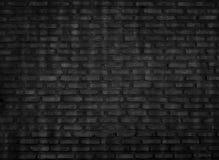 A parede de tijolo preta é um fundo do estilo do vintage imagens de stock