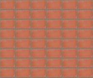 Parede de tijolo simétrica vermelha do teste padrão para o fundo Fotografia de Stock Royalty Free