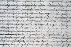Parede de tijolo áspera do fundo pintada com pintura branca Imagem de Stock