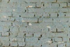 Parede de tijolo velha com pintura azul e textured Imagens de Stock