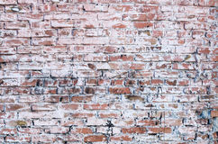Parede de tijolo velha manchada com a pintura Foto de Stock Royalty Free
