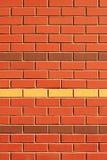Parede de tijolo vermelho com fileiras da característica Imagem de Stock Royalty Free