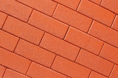 Parede de tijolo vermelho como um fundo agradavelmente textured foto de stock royalty free