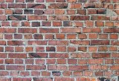 Parede de tijolo vermelho manchada resistida velha Foto de Stock Royalty Free