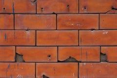 Parede de tijolo vermelho velha com alguma quebra Foto de Stock Royalty Free