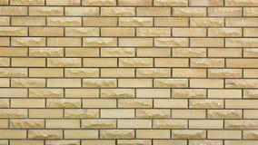 parede de uma pedra decorativa amarela selvagem Fotos de Stock Royalty Free
