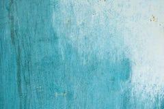 Parede desigualmente colorida com pontos Textura pintada da parede Fundo abstrato azul Imagens de Stock
