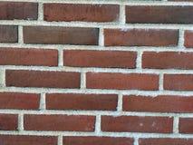 Parede dos tijolos vermelhos Fotos de Stock