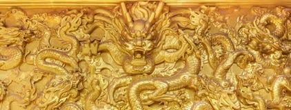 Parede dourada do dragão Fotografia de Stock
