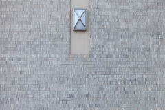 Parede e lâmpada de pedra modernas de tijolo Imagens de Stock Royalty Free