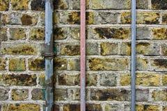 Parede e tubulações velhas Foto de Stock