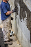 Parede exterior do porão que waterproofing 3 Fotografia de Stock Royalty Free