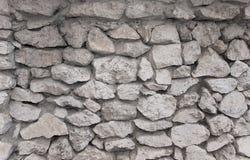 Parede feita do teste padrão textured tijolos do arenito Fotos de Stock