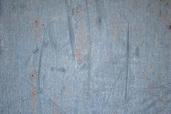 Parede gasto desigualmente colorida Pinte manchas na textura da parede Fundo abstrato cinzento Imagens de Stock