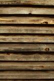 Parede marrom rústica feita de pranchas de madeira Fundo natural Imagens de Stock Royalty Free