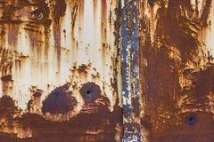 Parede oxidada do ferro com buracos de bala Imagens de Stock Royalty Free