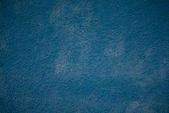Parede pintada do grunge dos azuis marinhos estuque decorativo abstrato bonito fotos de stock royalty free