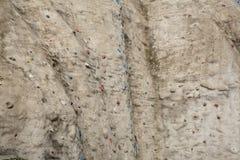Parede rocha-textured de escalada artificial Fotos de Stock