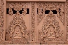 A parede tem uma imagem da Buda imagens de stock royalty free