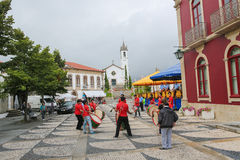 Paredes de Coura in Norte region, Portugal. PAREDES DE COURA, PORTUGAL - AUGUST 8, 2014: Folkloristic drum band in the center of Paredes de Coura in Norte region Royalty Free Stock Photos