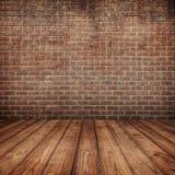 Paredes de ladrillo concretas y piso de madera para el texto y el fondo Imagenes de archivo