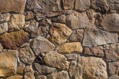 Paredes de piedra de la pared vieja de piedra amarilla Imágenes de archivo libres de regalías