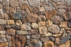 Paredes de piedra de la pared vieja de piedra amarilla Foto de archivo