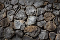 Paredes llenadas para arriba por las rocas Foto de archivo