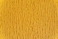 Paredes texturizadas amarillas de la textura del fondo Dise?o del papel pintado foto de archivo