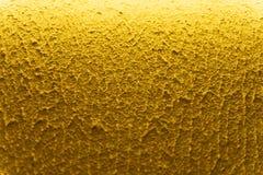 Paredes texturizadas amarillas de la textura del fondo Dise?o del papel pintado fotografía de archivo libre de regalías