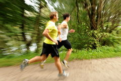 Pareggiare/che corre di due giovane atleti Fotografia Stock