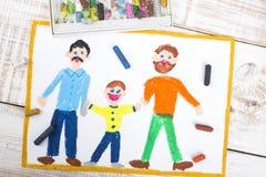 Pareja gay y niño adoptado Foto de archivo libre de regalías