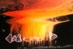 Parels in kleurrijke vloeistoffen stock foto's
