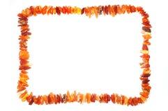 Parels van ruwe amber in een kadermening Royalty-vrije Stock Foto
