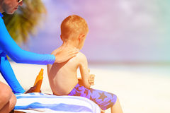 Parent applying sunblock cream on child shoulder Royalty Free Stock Photos