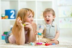 Parent and baby boy playing together at home Stock Photography