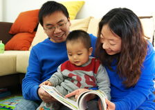 Parent and child. Reading together Stock Images