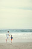 Parent and child at beach Stock Photography