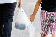 Parent and Child Carry Plastic Bags royalty free stock photography