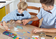 Parent and child drawing together. At home Royalty Free Stock Images