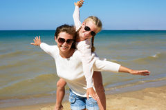 Parent and child happily spend time together. Stock Photos